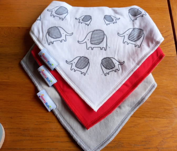Dotty fish bibs, one grey, one red and one white with Nya the Elephant printed on.