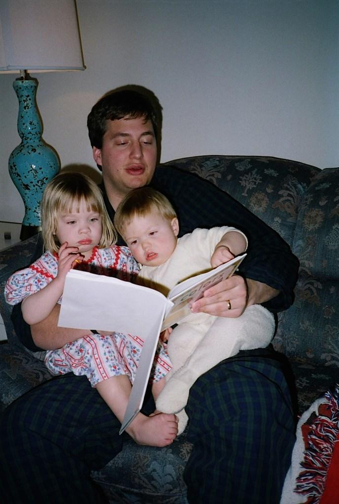 Lane reading to Sarah and Nate