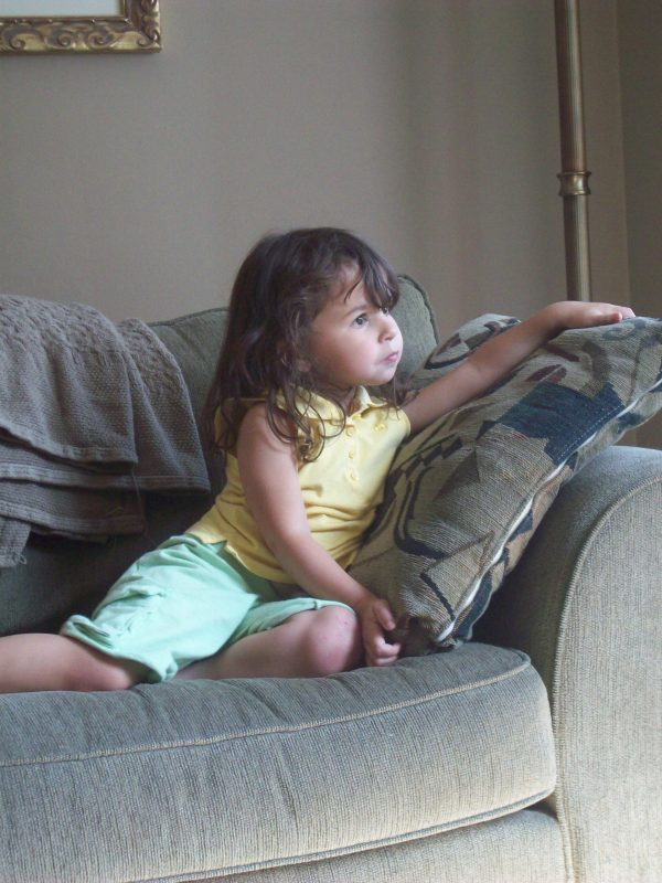 toddler relaxed looking out the window
