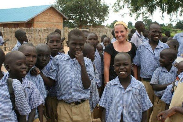Alisha with children in Uganda