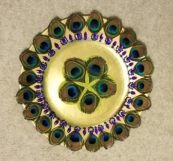 Decorated Gold Tone Plate with Peacock Feathers.