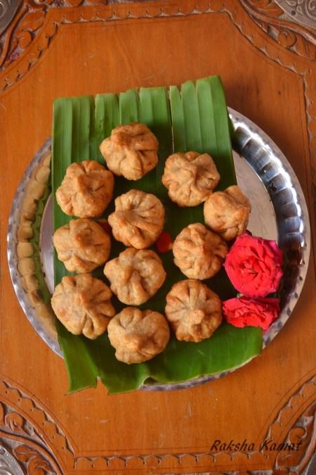 modak, Deep fried modak, Indian dumpling with grated coconut and jaggery