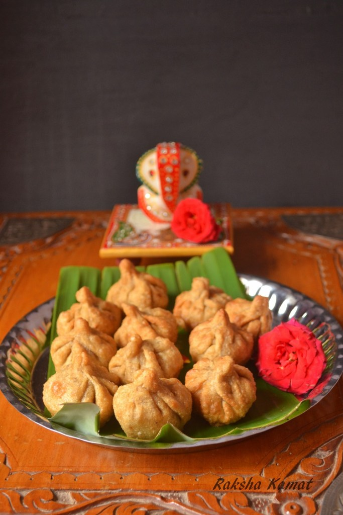 modak, Deep fried modak, Indian dumpling with grated coconut and jaggery