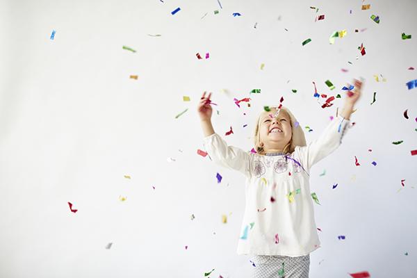 Little Girl Catching Confetti