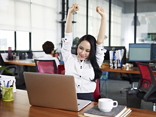 Businesswoman Stretching Arms in Air