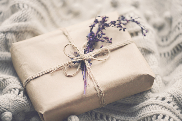 Paper wrapped gift with sprig of lavender
