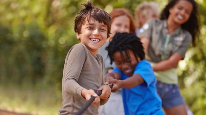 Kids playing tug of war at summer camp