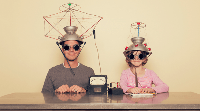Dad and daughter experimenting with electronics