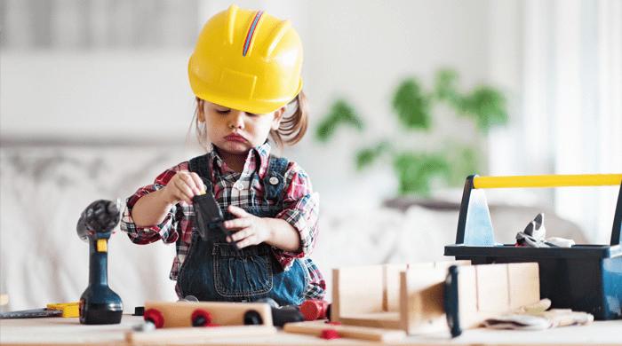 Little girl in construction hat