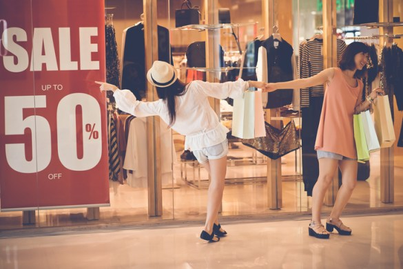 Pair of shoppers going to a big sale