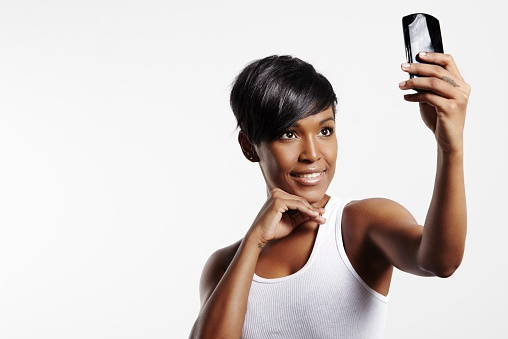 Pretty woman making selfie with mobile