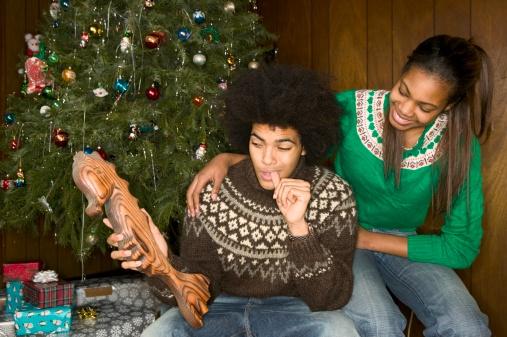 African American man receiving odd Christmas present