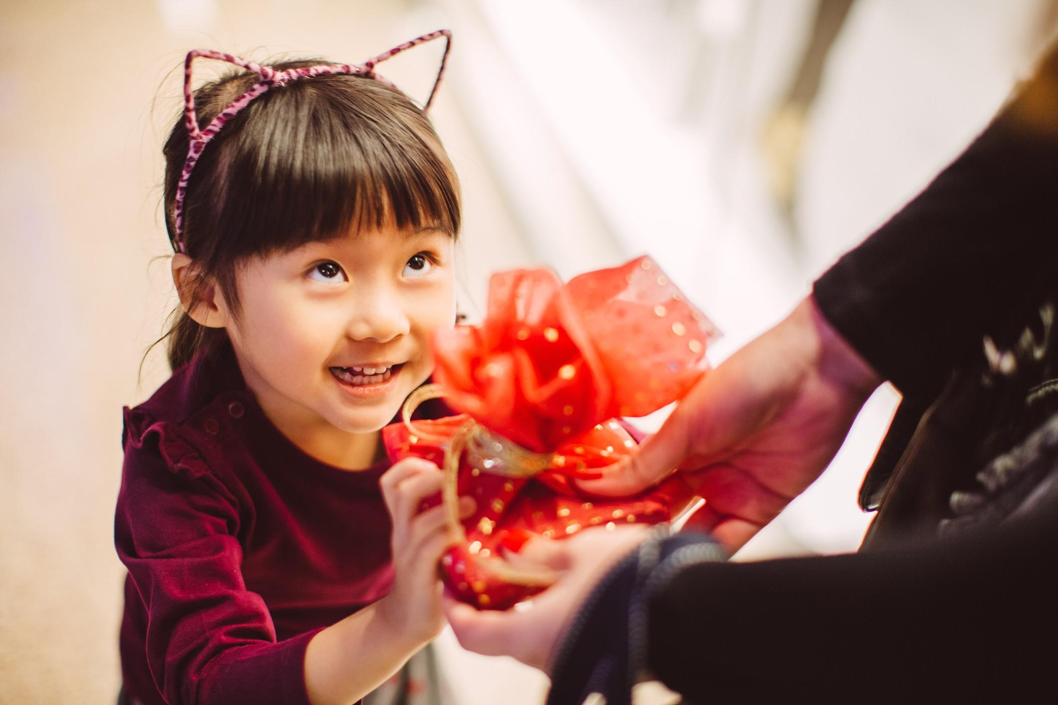 Little girl wearing cat ears