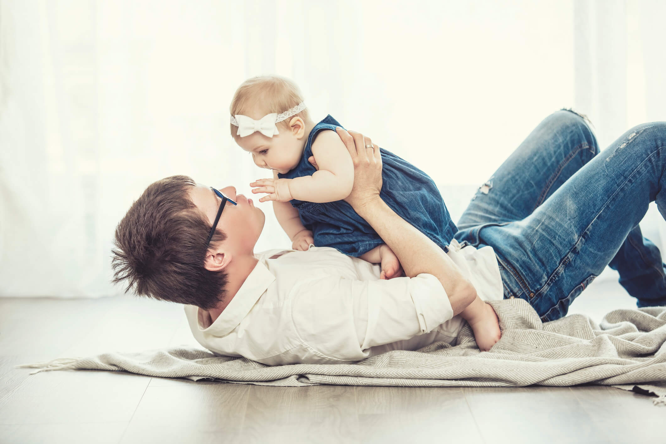 Dad playing with baby