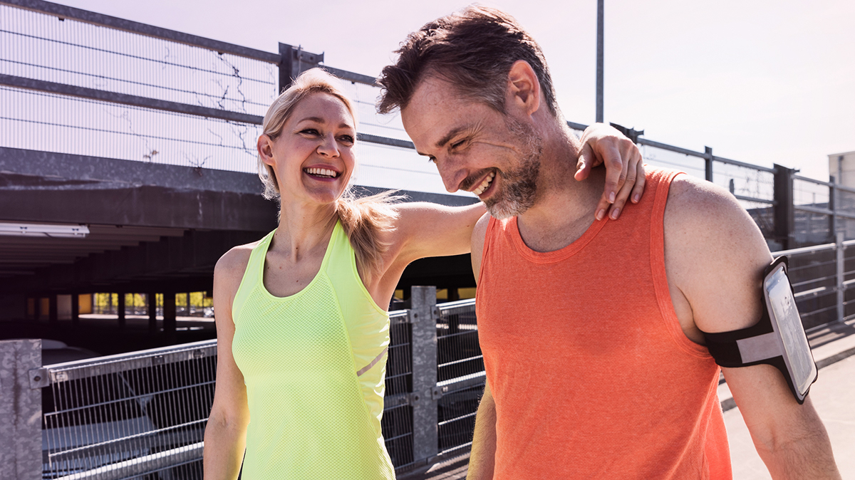 A man and woman in fitness apparel