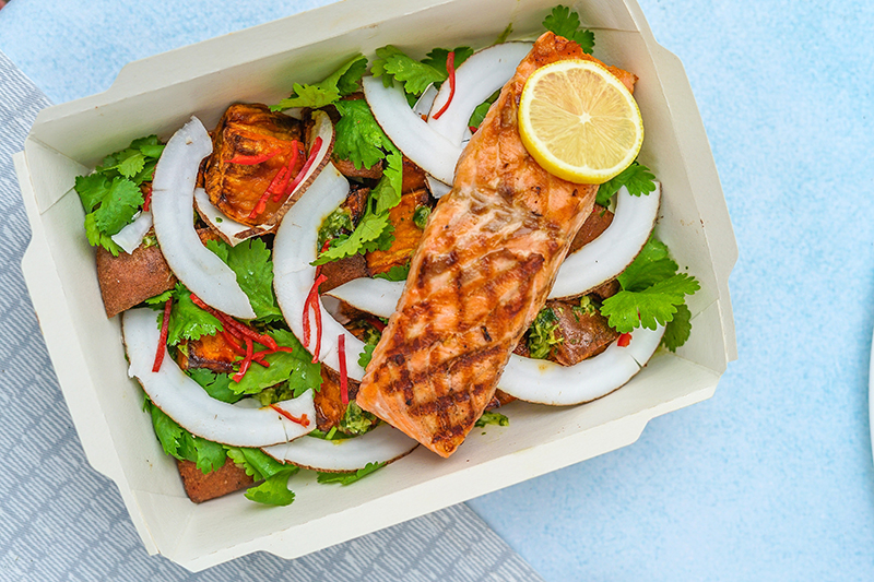 Salad with salmon in a box