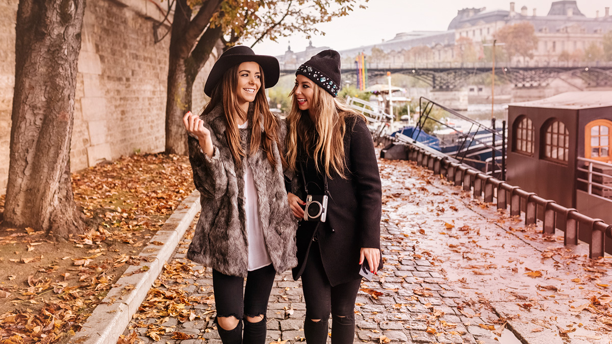 Two fashion girls walking together