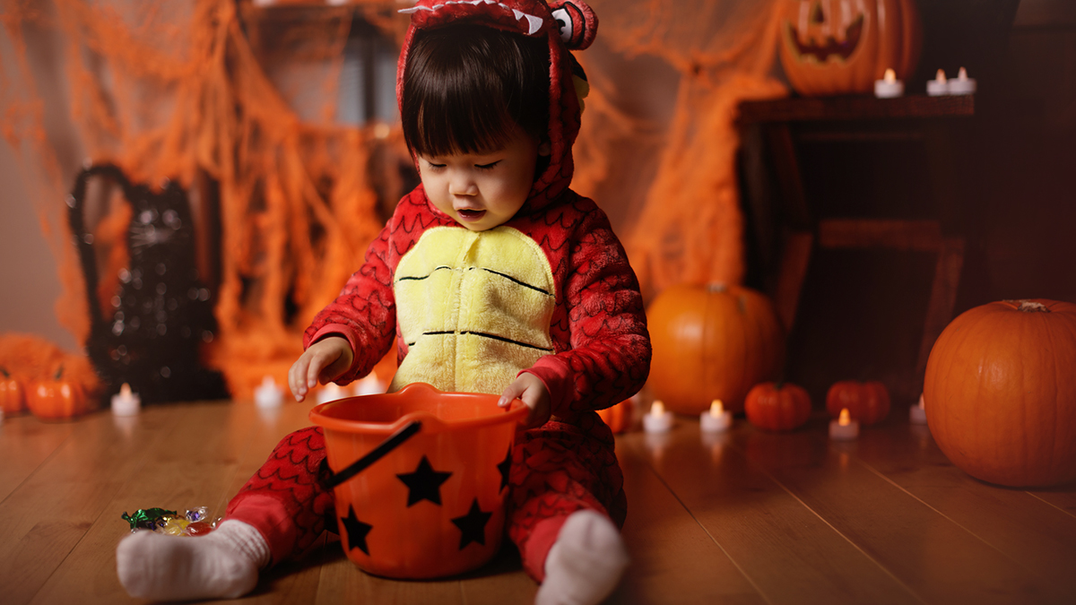 Baby in a dragon Halloween costume