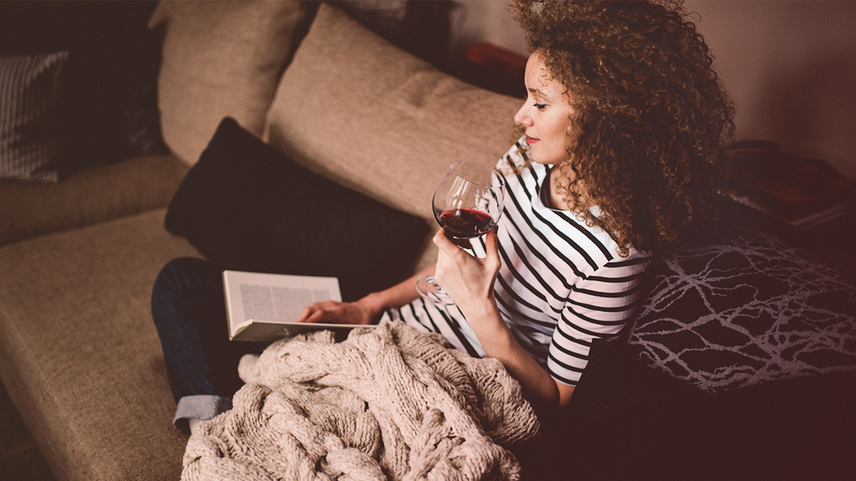 Girl with wine and a book