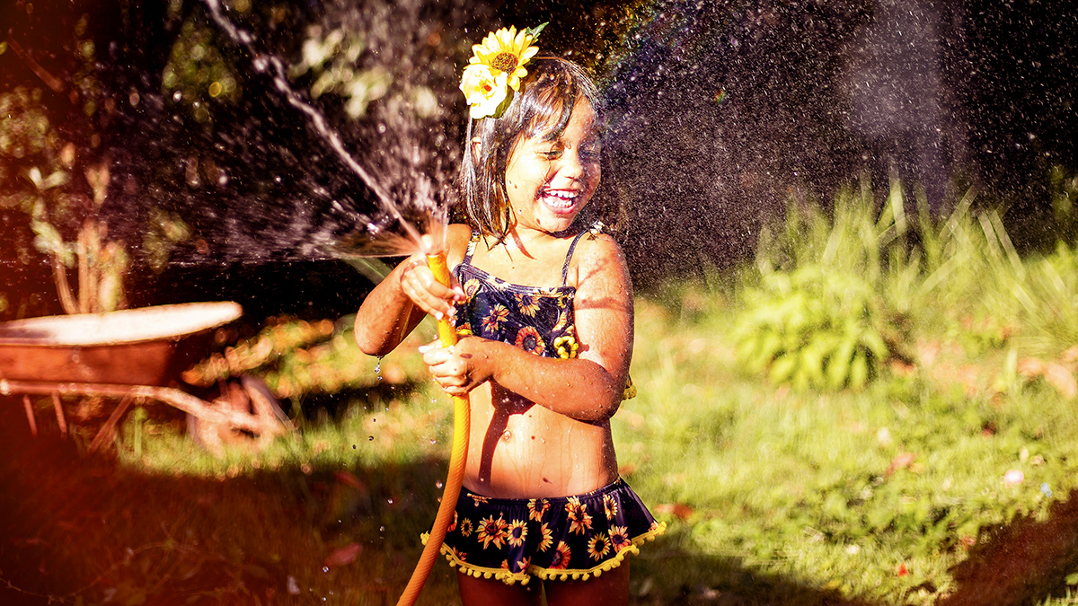 girl playing with hose