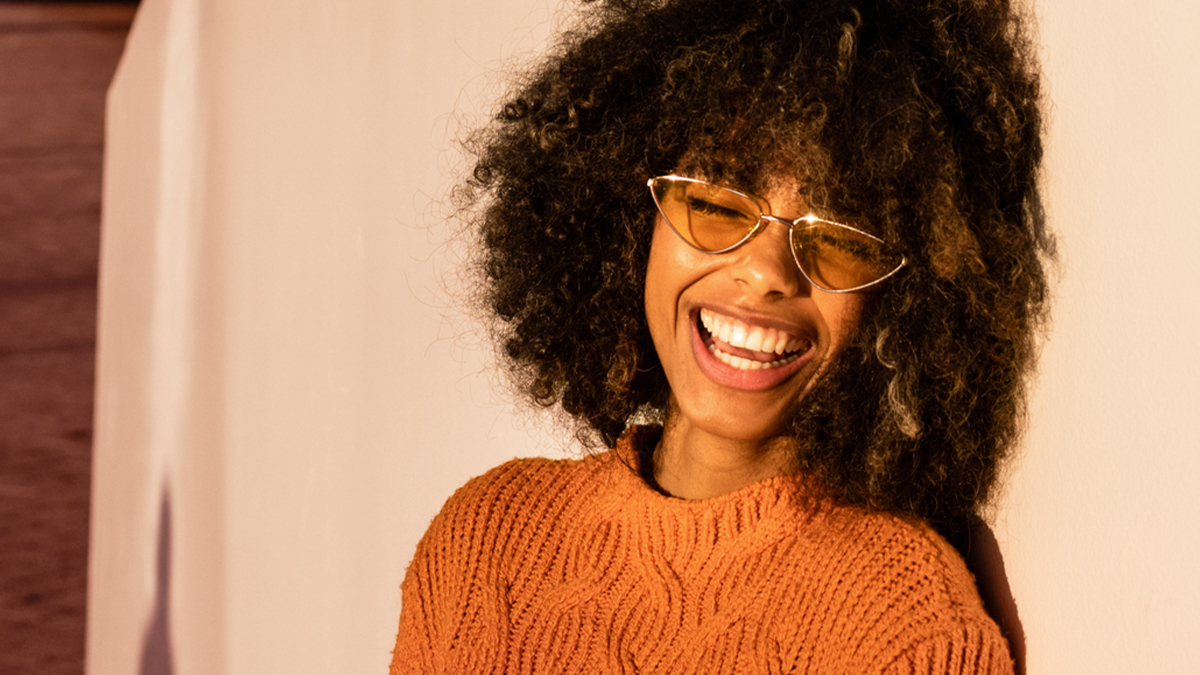 Girl in sunglasses and sweater