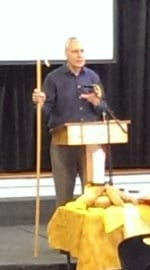 Duane preaching with shepherd's crook