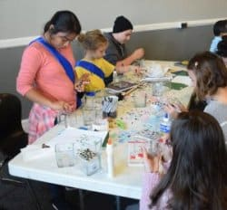 Young people creating at the art table during RMC worship
