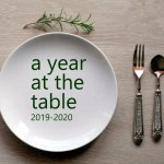 Place setting with A Year at the Table in text over the plate