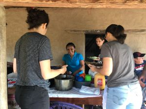 Breakfast table set up on the porch of the chapel/community center of Colón. Woman service is pictured with Angel, Melissa and Jackie.