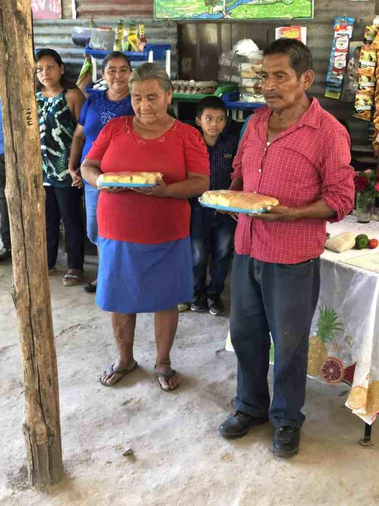 Two people sharing unique communion elements in El Salvador.
