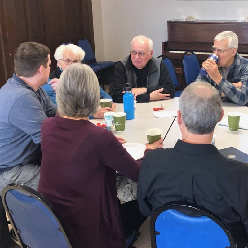 A group around the table at the pop-up seminary on Feb. 15, 2020
