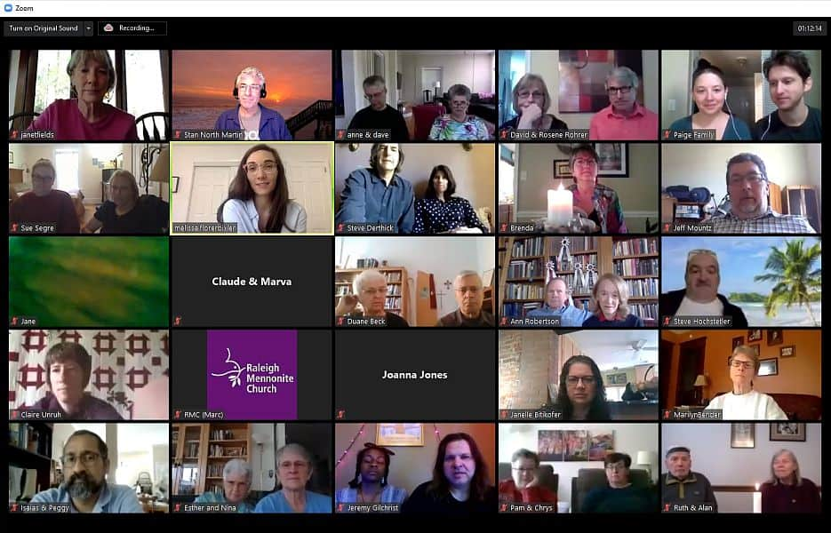 Zoom meeting gallery view with many people online from their own homes.
