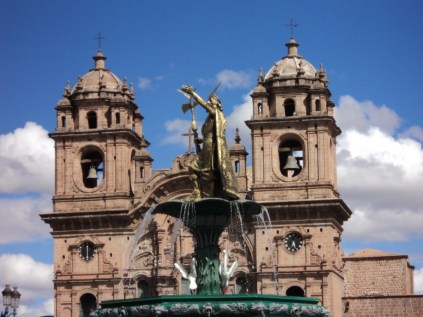 Inca statue and colonial church.