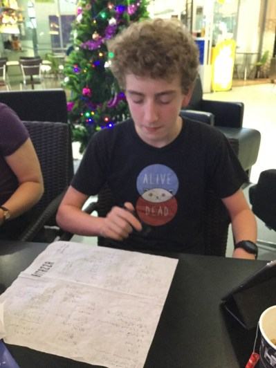 Callum working out a formula for relativity in the airport.