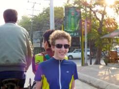 Callum riding a trishaw.