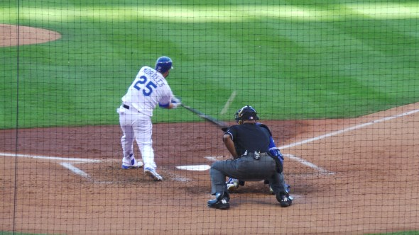 Kendrys Morales lines a single in ALCS Game 2 [Photo by Chris Kamler]