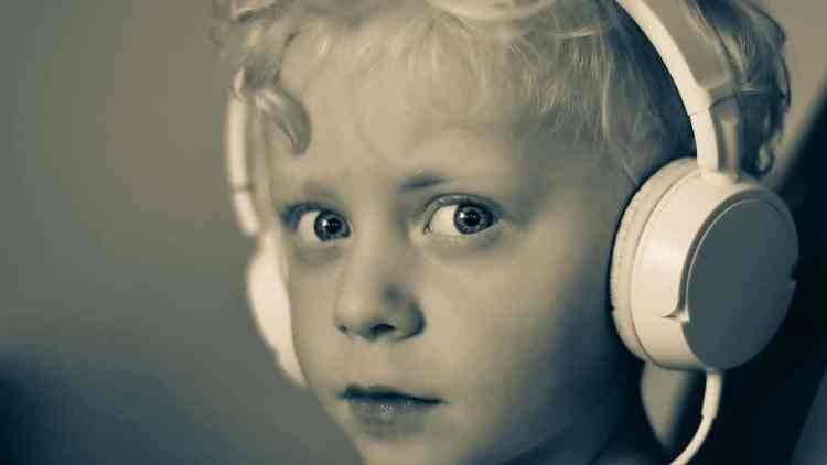 child with headphones boy child headphones white music