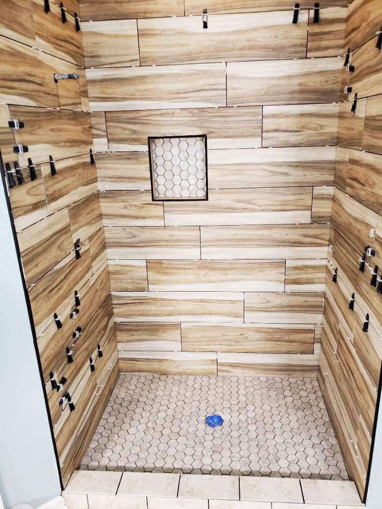San Antonio Shower Remodel with Wood-like Tile and Glass Doors
