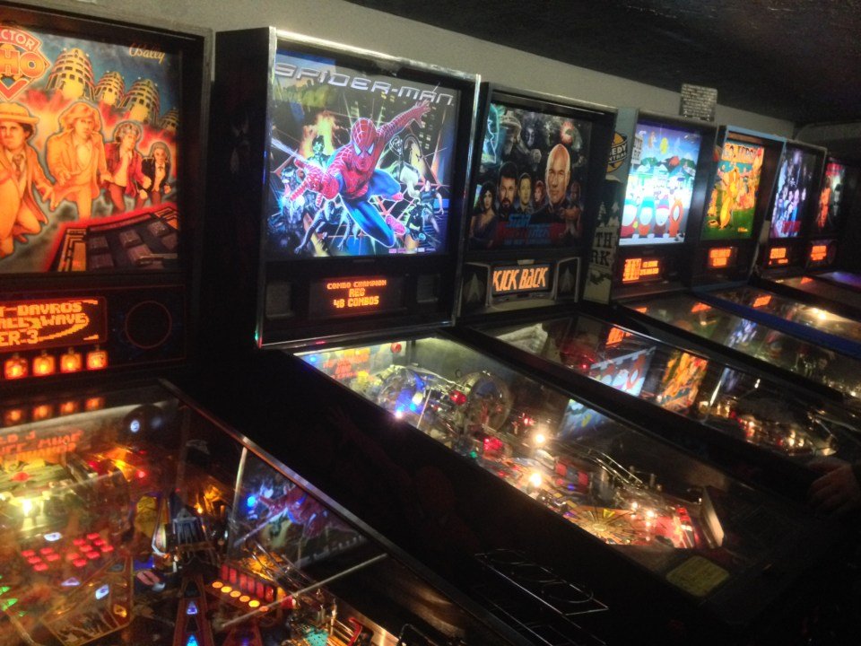 Row of classic pinball machines at Ground Kontrol in Portland