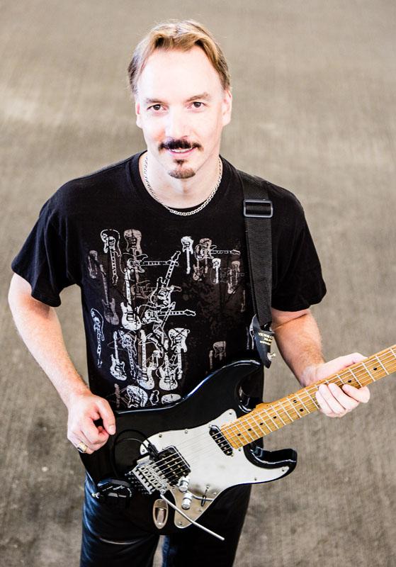 Randy Ellefson with guitar, 2013