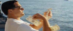 man-throwing-money-on-the-beach