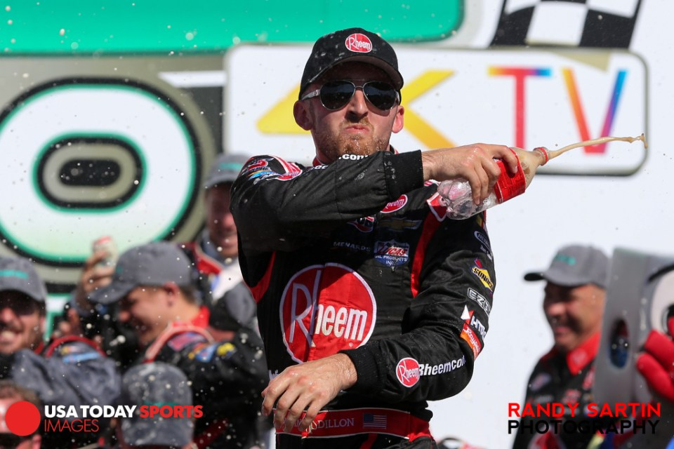 May 23, 2015; Concord, NC, USA; NASCAR Xfinity Series driver Austin Dillon (33) celebrates winning the Hisense 300 at Charlotte Motor Speedway. Mandatory Credit: Randy Sartin-USA TODAY Sports