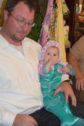 The cutest little mermaid! Look at that tail! Aubrey with dad.
