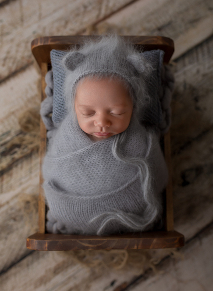 Matthew Cramer Photograpy's image of a newborn done with Photoshop and an iPhone.