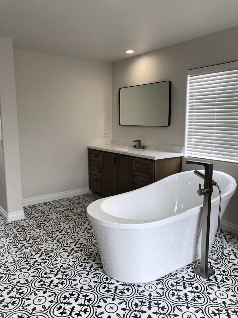 black and white bathroom, freestanding tub, new modern, las vegas bathroom, slipper tub, custom shaker stained cabinets, stainless steel pulls, undermount sink, white subway tile, Delta Ara, patterned tile