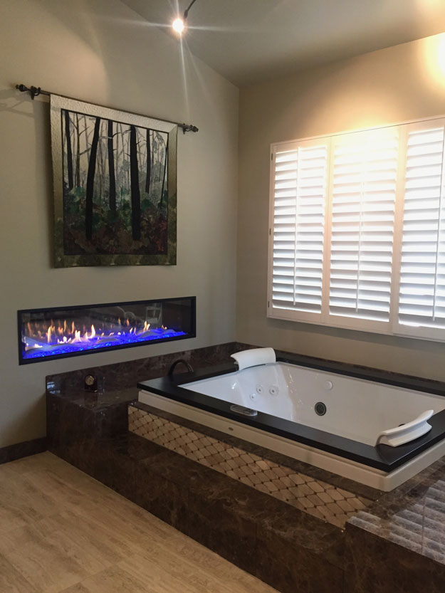 oil rubbed bronze faucets, white raised panel cabinets, dark wood raised panel cabinets, dark emperor marble, light emperor marble, jetted tub, two person tub, linear fireplace, porcelain tile, radiant heat flooring, frameless shower enclosure, mosaic tile, oil rubbed bronze hardware, recessed medicine cabinet