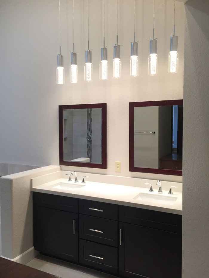 chandelier pendant light, chrome fixtures, chrome faucet, framed mirror, quartz countertop, espresso shaker vanity, chrome cabinet pulls