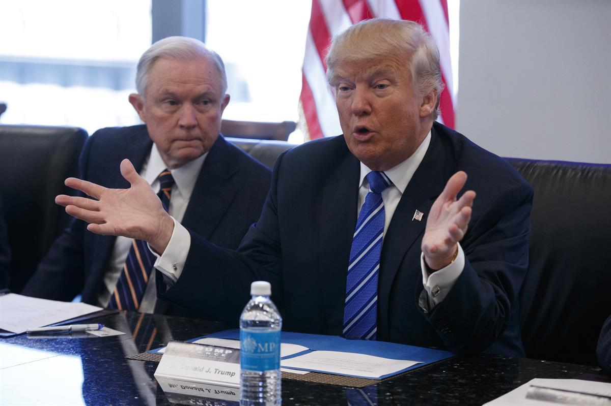 Jeff Sessions and Donald Trump during a national security meeting with advisers at Trump Tower in New York on Oct. 7, 2016 (AP Photo/ Evan Vucci, File)