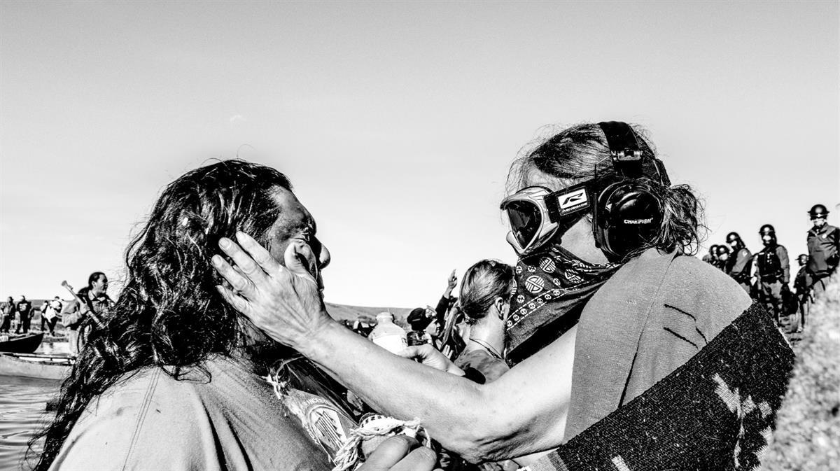 Indigenous Protector is maced by militarized police at the Missouri River — Rob Wilson Photography