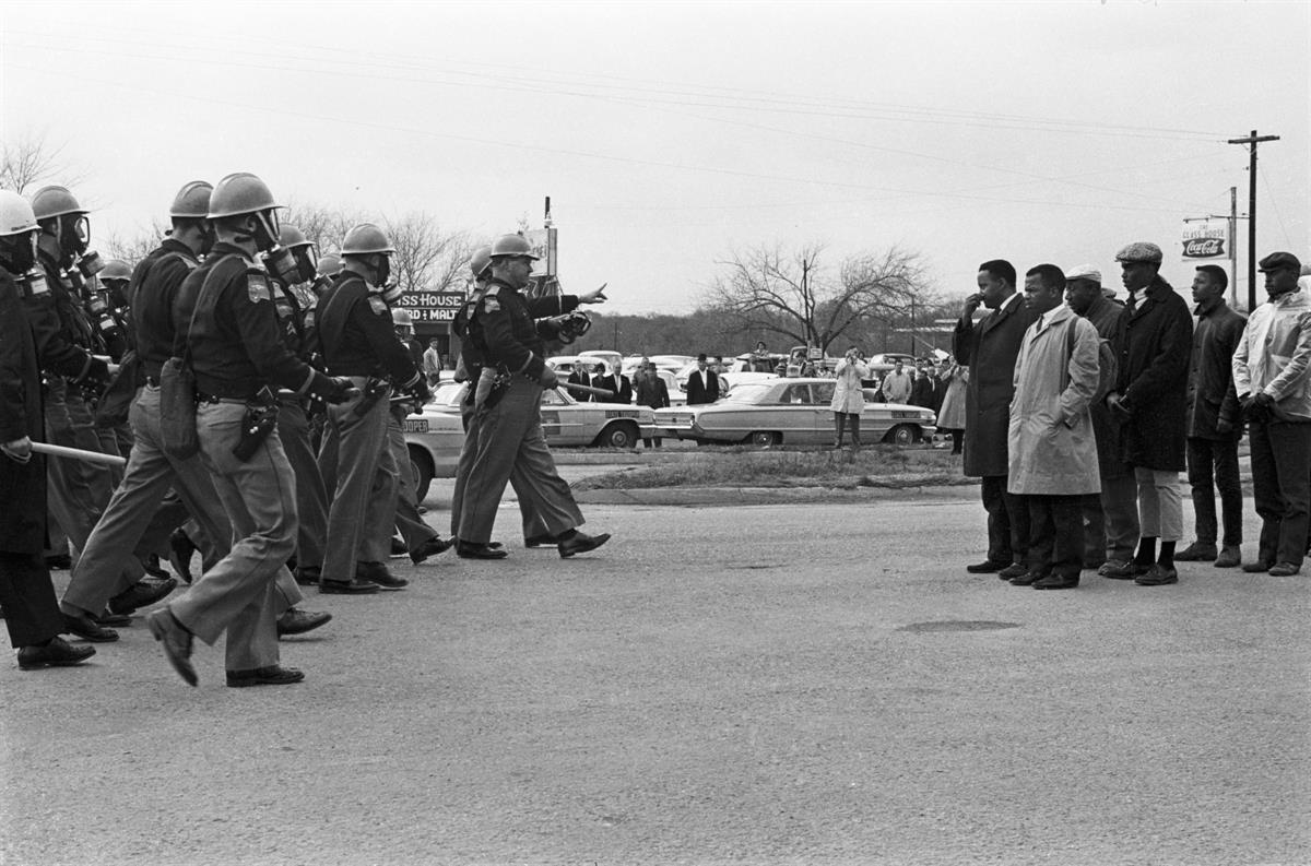 Police advance on John Lewis and fellow civil rights activists